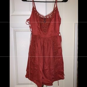 Dress with lace front and lace up sides